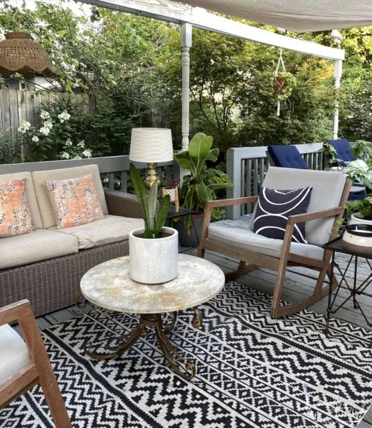 Black and white rug on back deck and rocking chairs