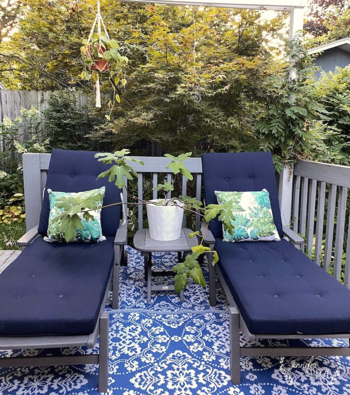 Navy and grey lounge chairs with boho tropical plant pillows by Jennifer Rizzo