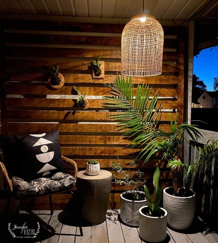 Back patio area with boho styling and plants in large white pots