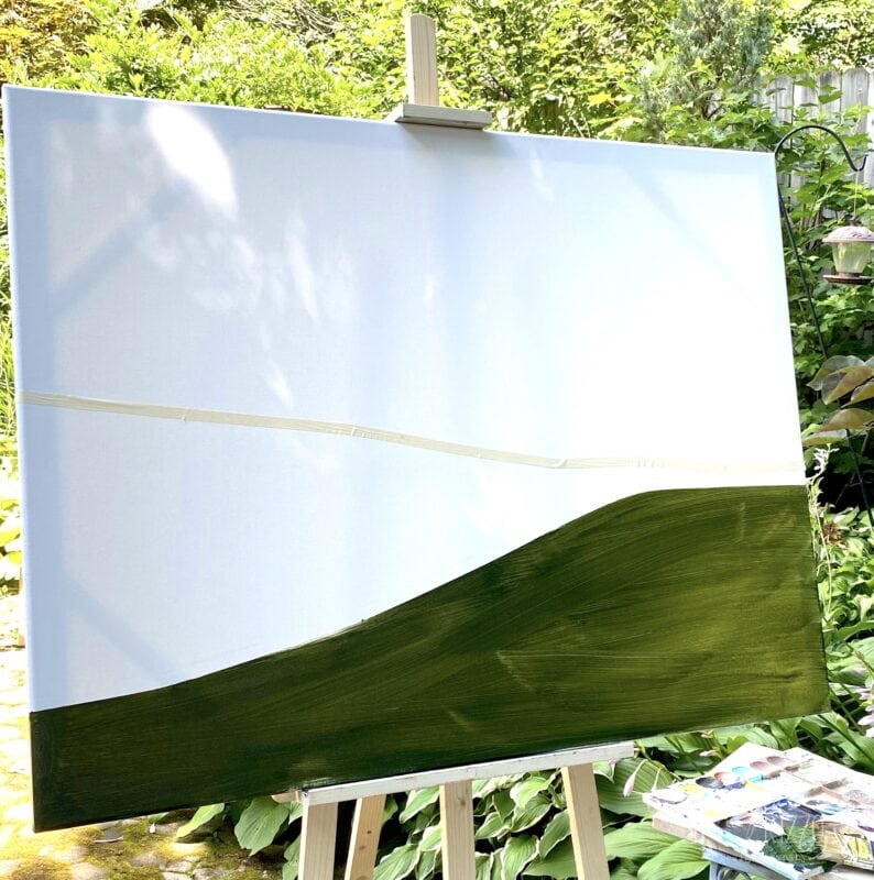 Once the base color is painted, add the next layer of paint to your abstract landscape painting
