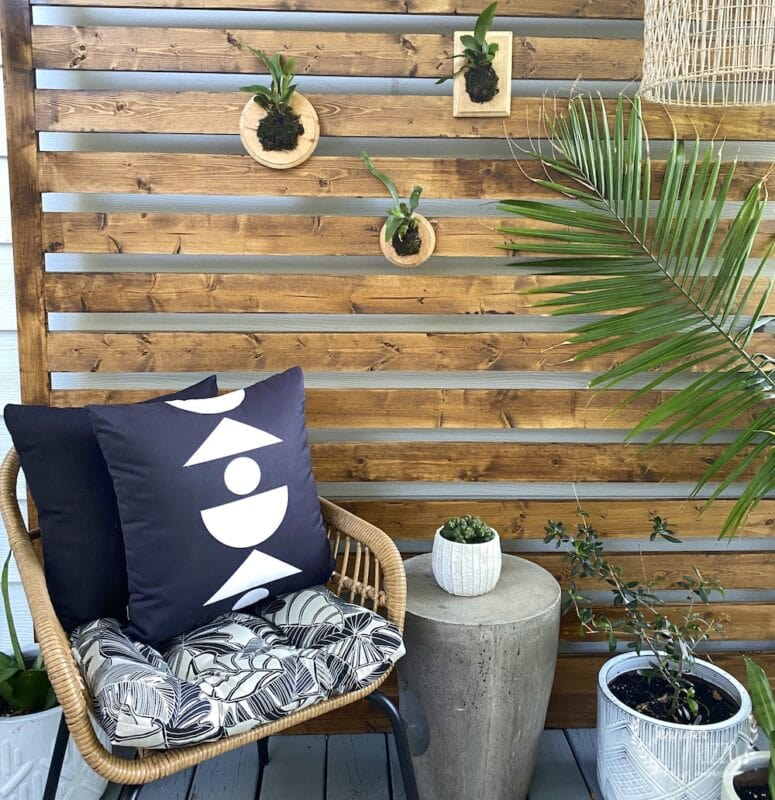Balanced shapes geometric pillow and wood panel deck wall makeover privacy wall on the deck