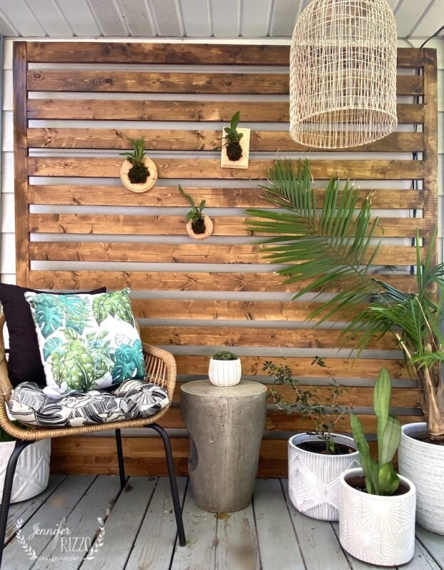 Wood privacy panel on deck with plants and boho styling