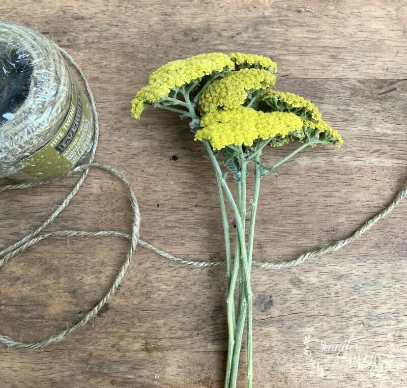 Tying flowers with twine for dried flower arrangements
