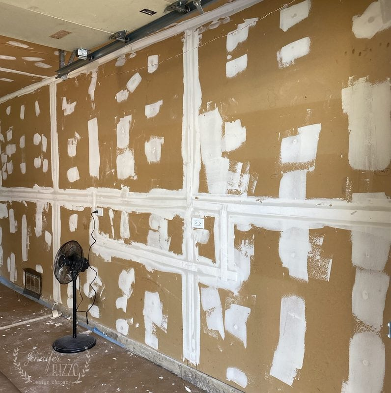 Mudding and Taping  the Drywall in the Garage