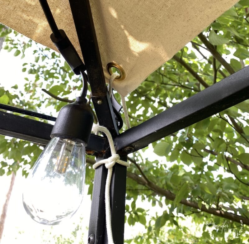 Grommet corners of easy no sew canvas canopy