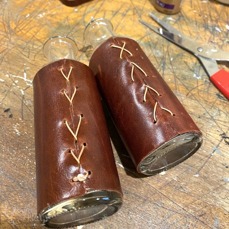Leather wrapped bottles with lacing