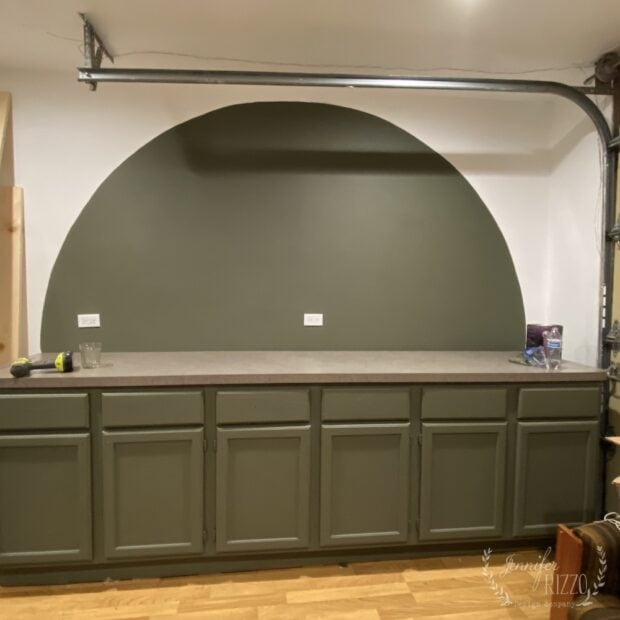 Painted arch accent wall in dark green wall paint