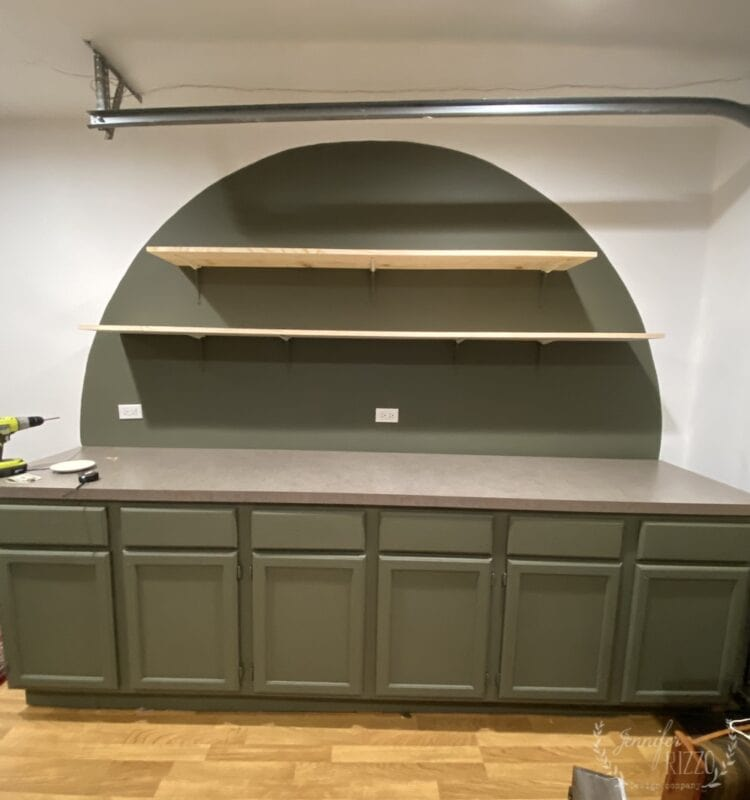 OPen shelving in a painted arch wall