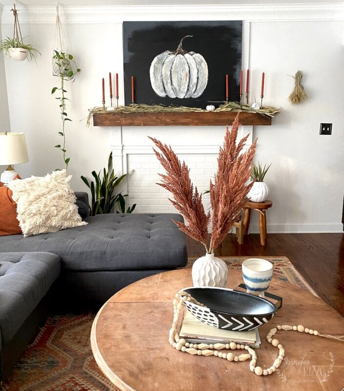 Boho Fall living room with rustic pumpkin canvas