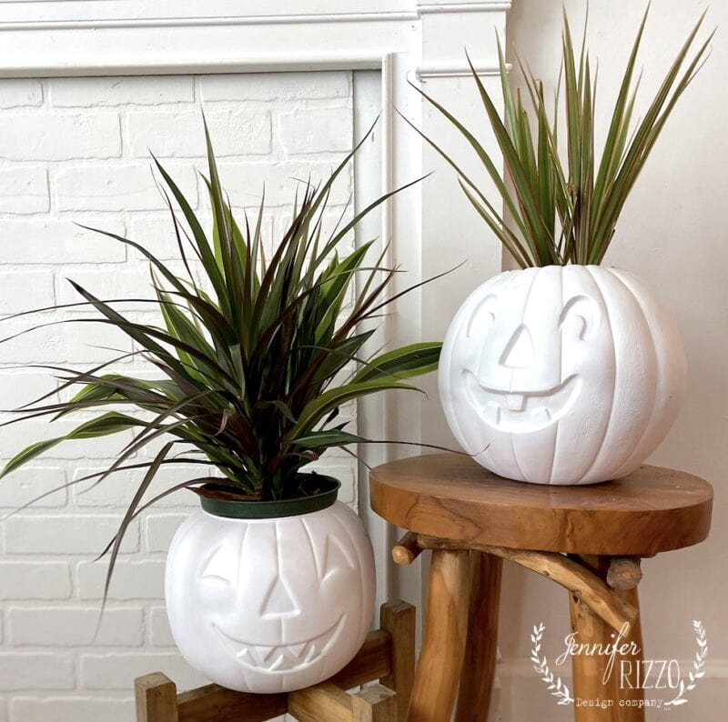 Cute spray painted jack o lanterns into planters