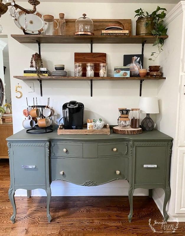 Open shelf styling over a dark green painted buffet