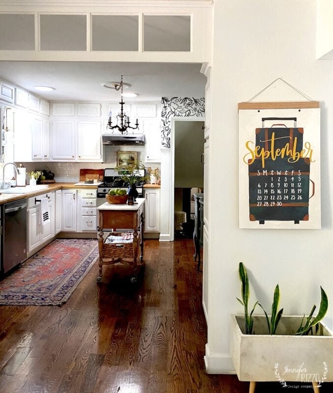 White cabinets in kitchen with boho decor