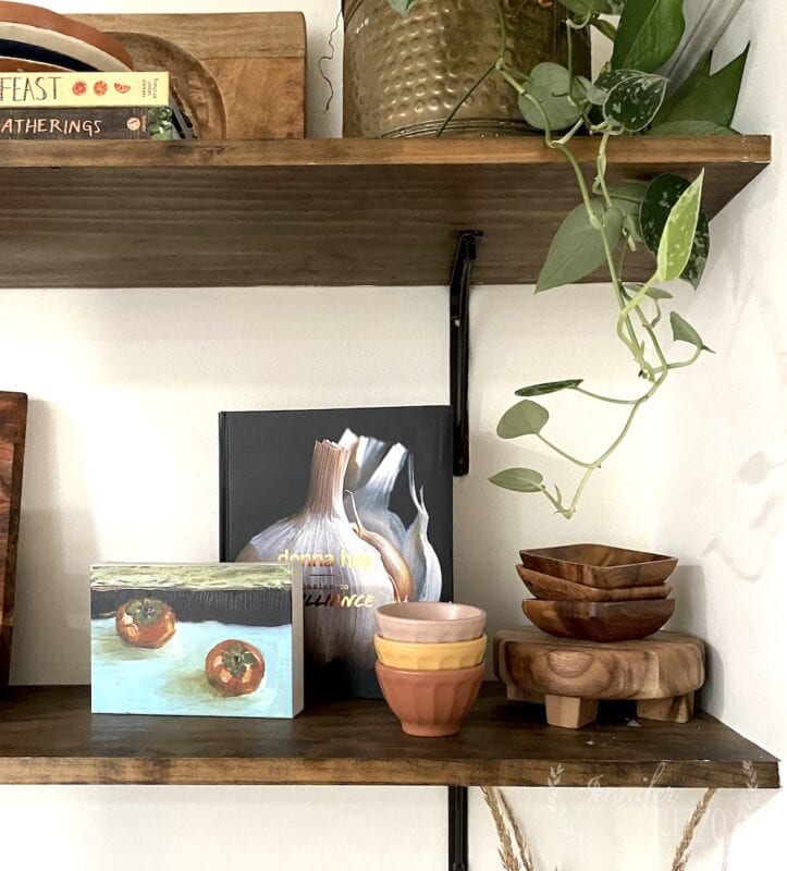 Styling open shelves with art