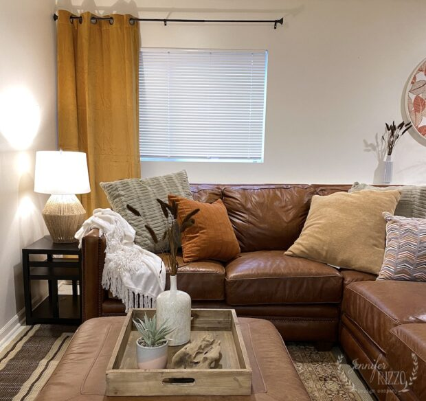 Creating a cozy basement family room with rust and yellow