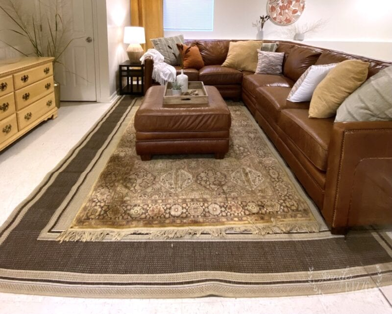 Layer rugs to make a smaller rug seem bigger