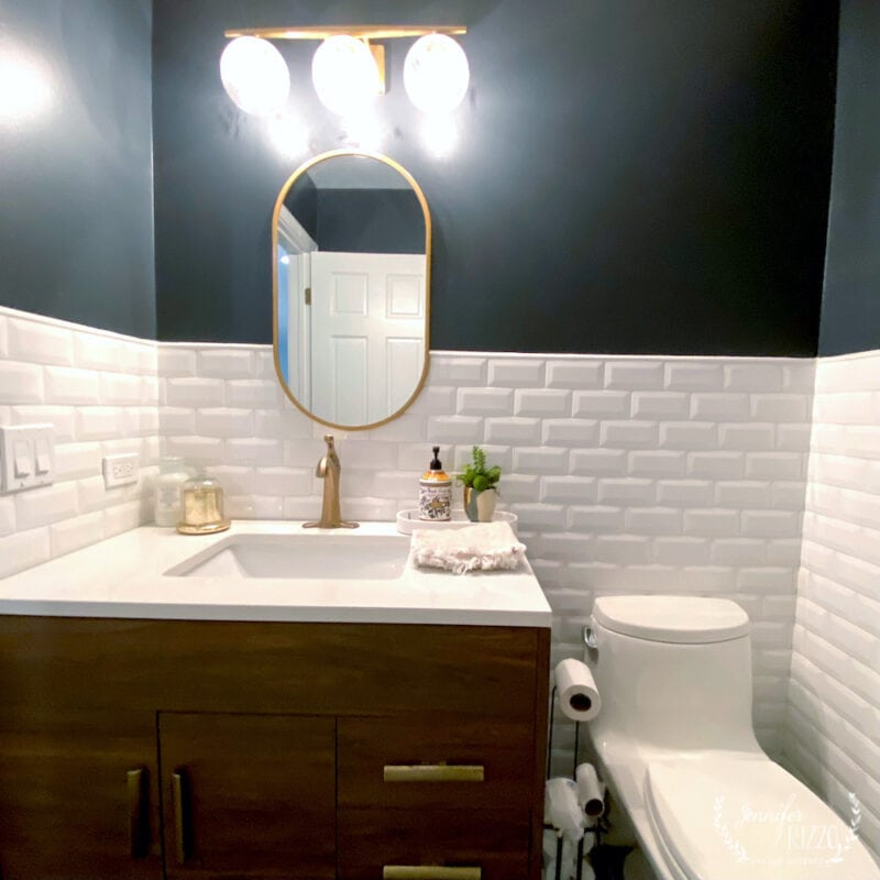 White beveled subway tile and dark gray wall paint in bathroom