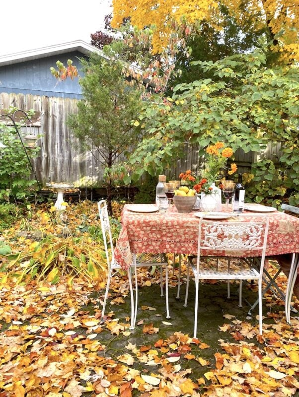 Outdoor tablescape with marigolds in fall