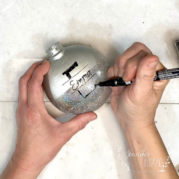 Personalize an ornament with a paint marker DIY