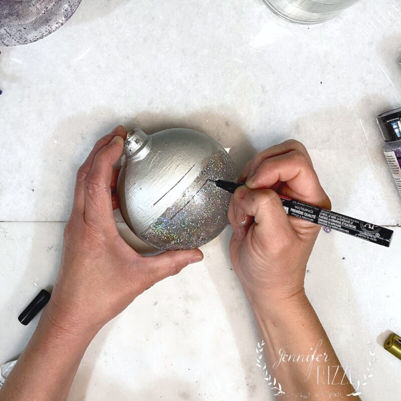Use a paint marker to personalize an ornament