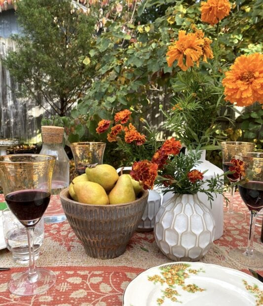 Fall tablescape with marigolds and fruit