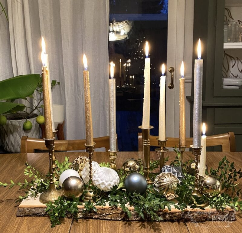 Skinny centerpiece with brass candle sticks and ornaments
