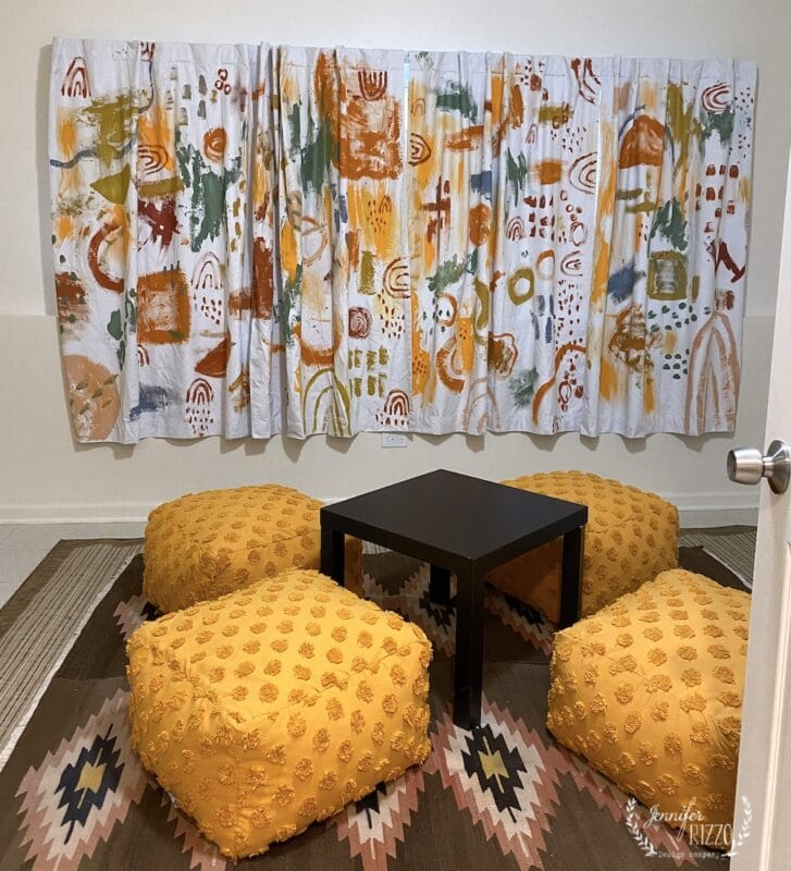 Hand painted abstract curtains in playroom