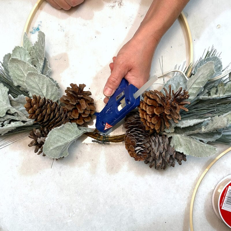 Hot glue to hold faux florals in place
