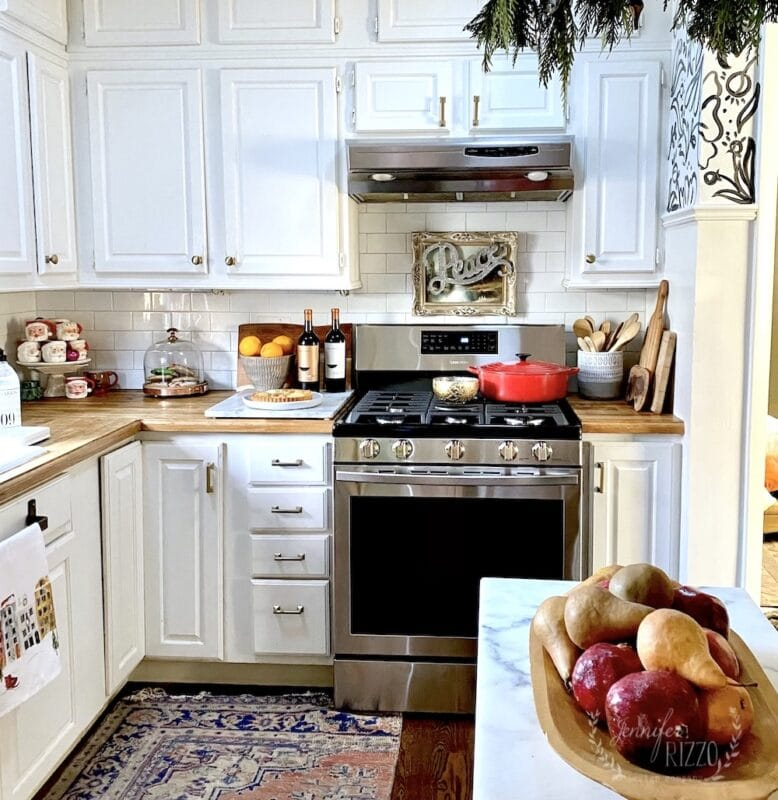 Simple Christmas kitchen with greenery and fruit