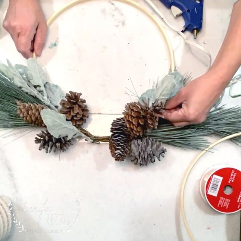 Tuck faux lambs ear into pine sprigs