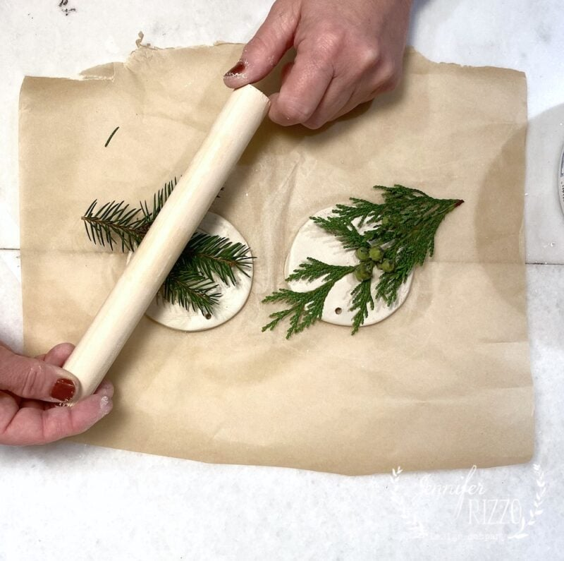 Use a dowel rod to press greens into clay