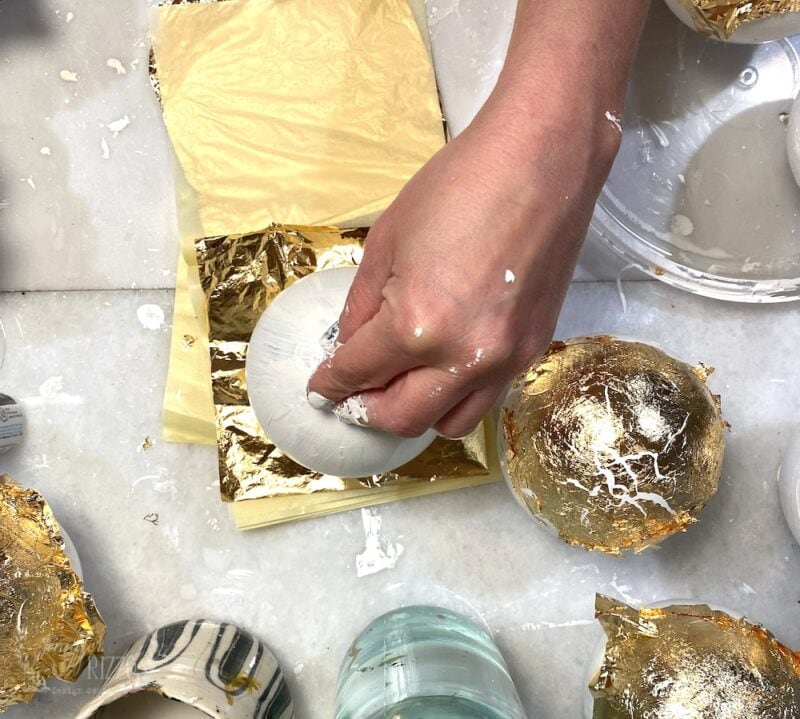 Dipping the ornaments onto Gold leaf