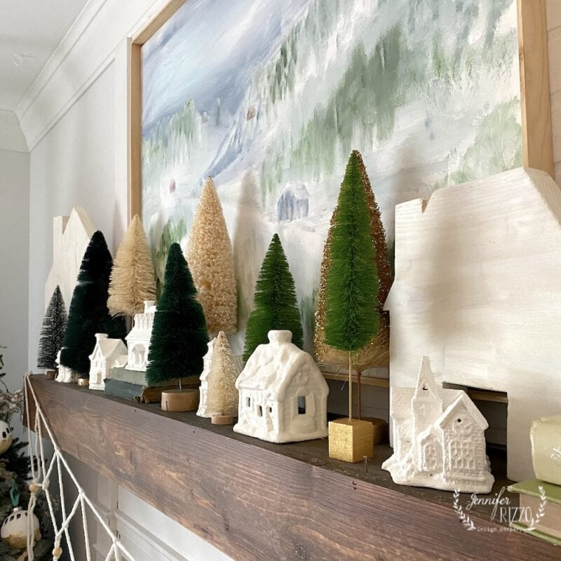 Mantelscape with bottlebrush trees and little houses