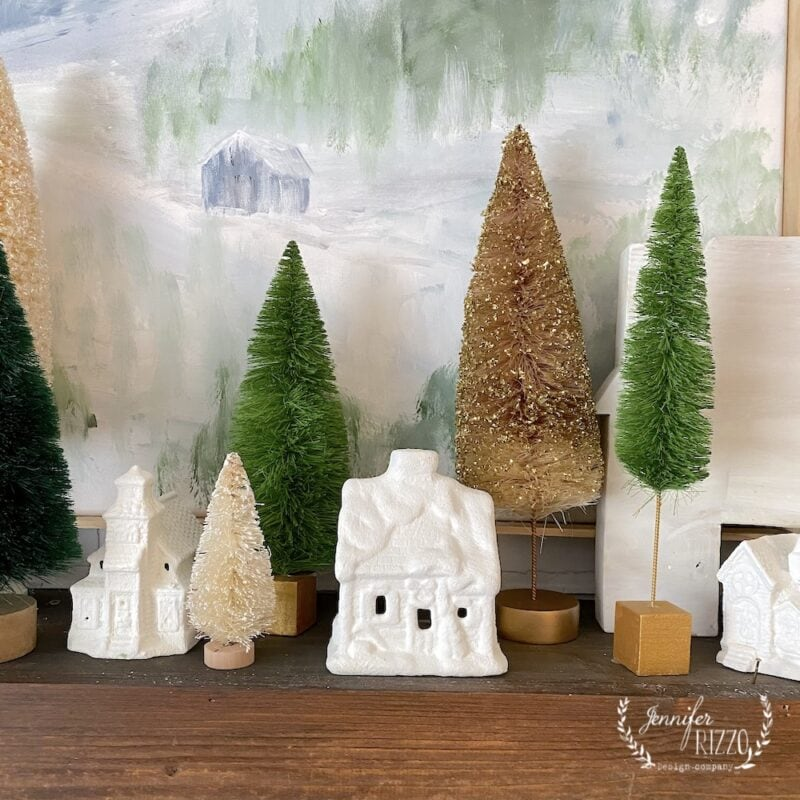Painted cottages and bottle brush trees mantel decor