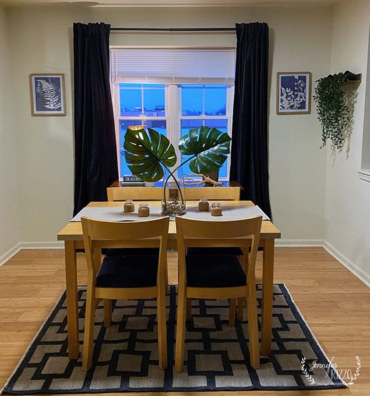 Small dining room design with a faux plant wall