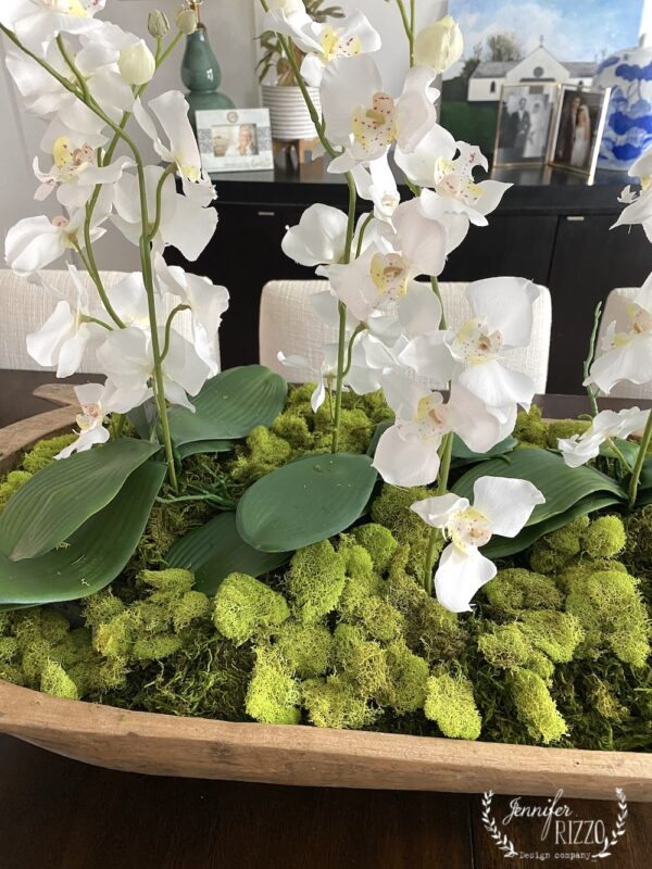 VIntage wood dough bowl style with faux orchids