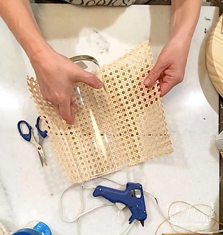 Wrap caning around the vase and glue for a DIY rattan caned vase