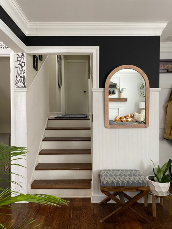 Black painted wall and sanded wood mirror split level