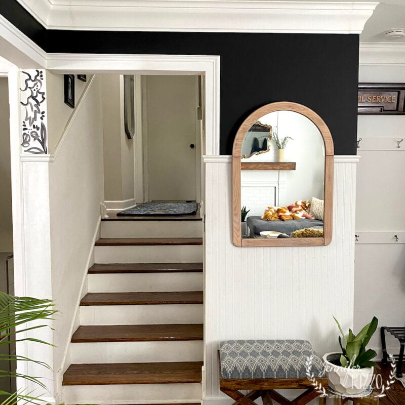 Black wall paint and sanded wood mirror