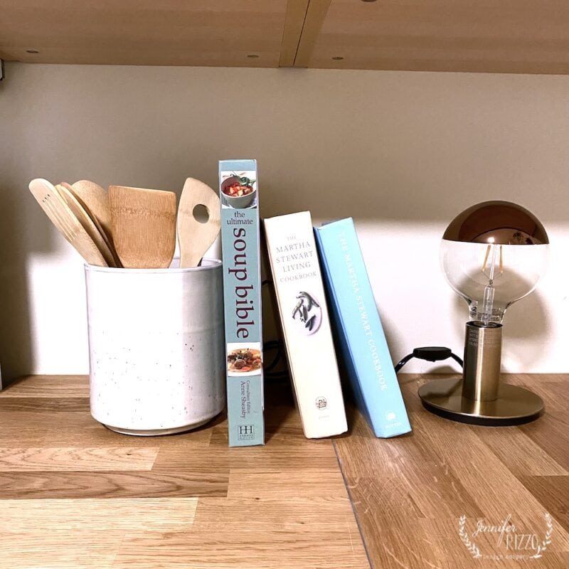 Cook books and lamp on wood countertops