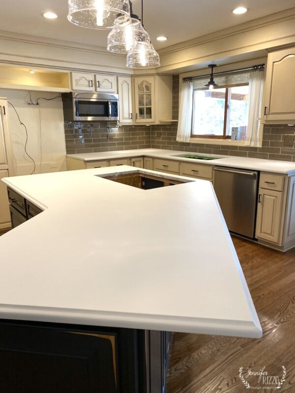 Granite countertop painted to look like marble white base coat