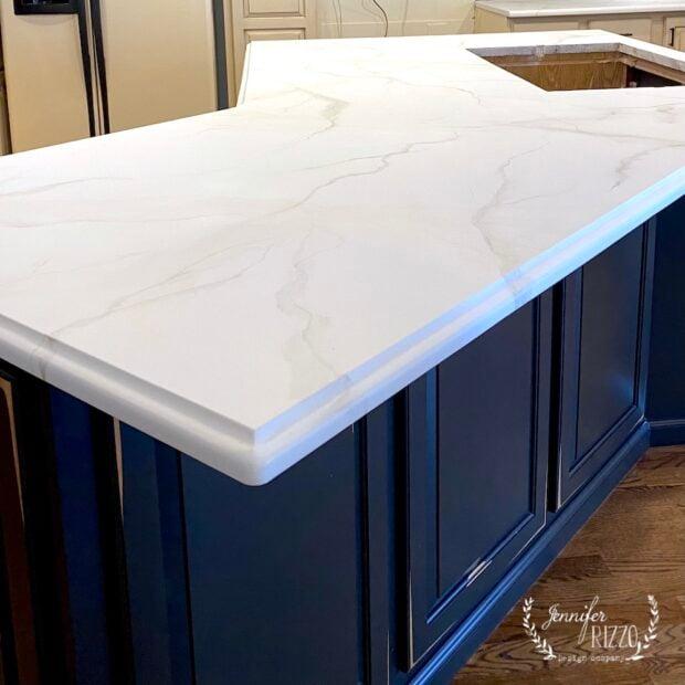 Granite countertops painted to look like marble