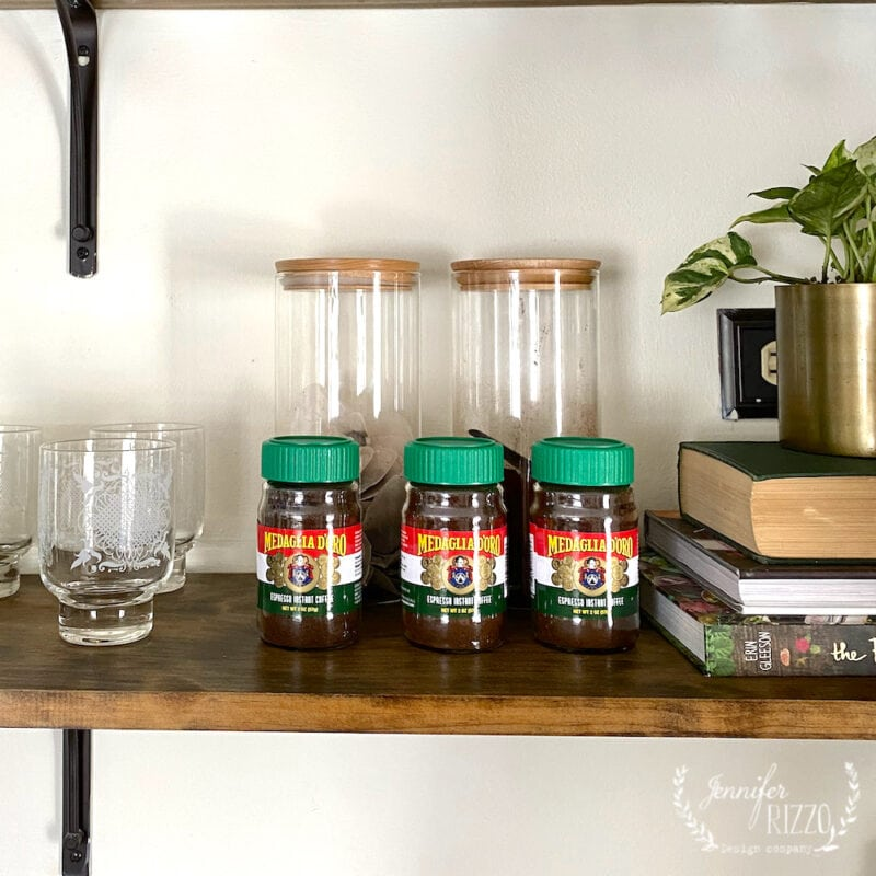 Styling open shelves with nonperishable groceries like these cute jars of instant coffee