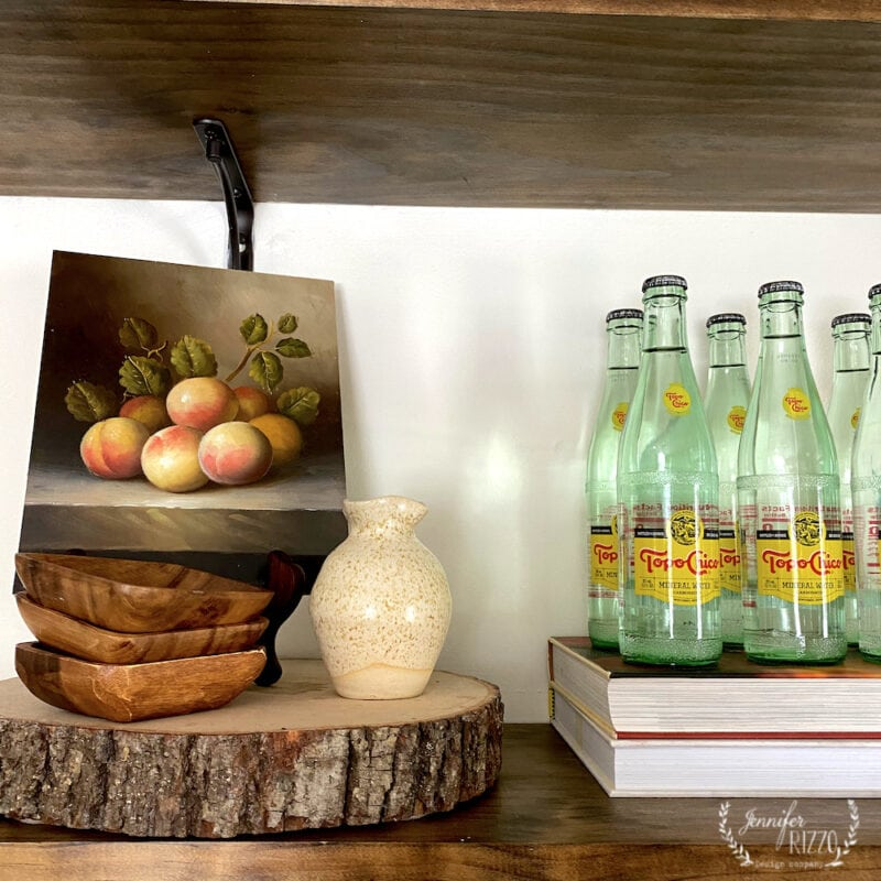 Styling open shelves with vintage art