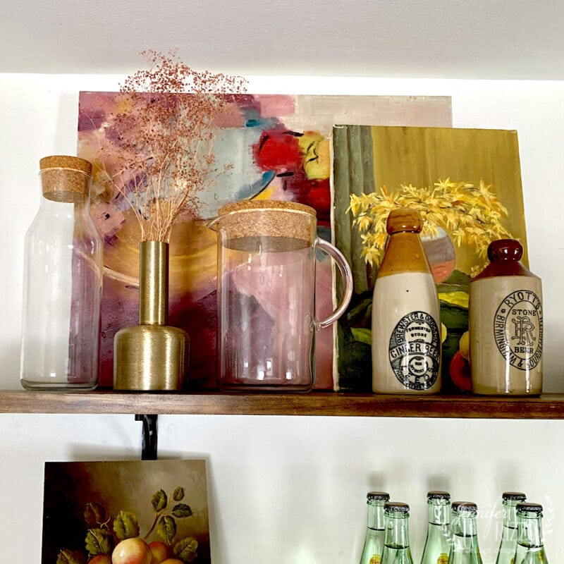 Using vintage art to style open shelves
