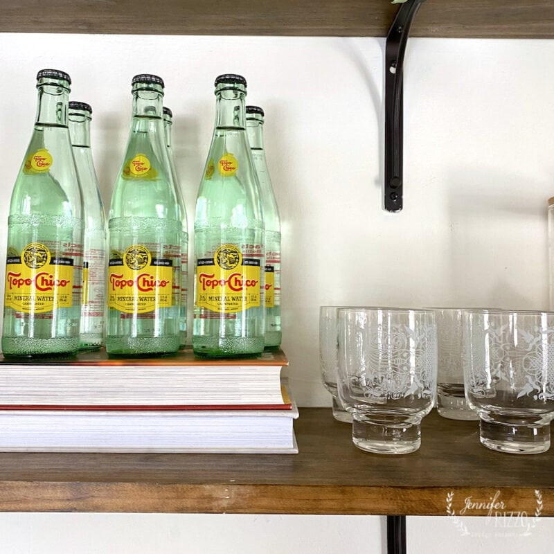 VIntage glasses and topo chico water on open shelving