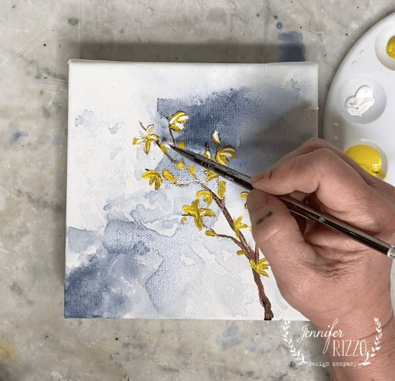 Add white paint to highlight flowers