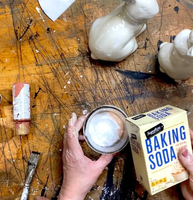 Mix baking soda and acrylic paint