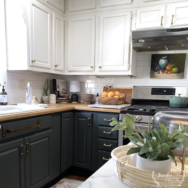 Painted dark green lower cabinets with white uppers