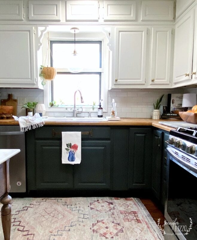 Painted lower cabinets with contrasting upper cabinets