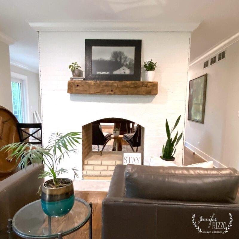 White washed fireplace and reclaimed barnwood mantel